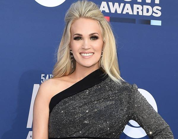 baa2281759 Carrie Underwood's not just a cool mom, she's a regular mom. Or so she  proclaimed as she walked the red carpet for the 2018 CMT Artists of the  Year Awards ...